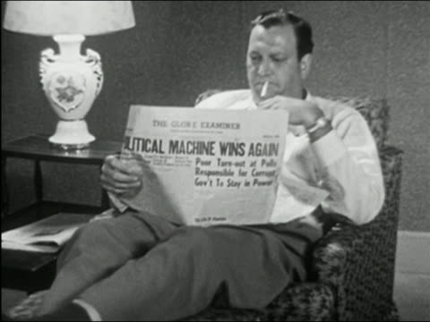 1955 black and white medium shot zoom out man sitting in armchair, smoking and reading newspaper with political headline