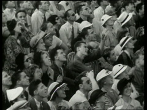 black and white people in audience looking up at air show / no audio - airshow stock videos & royalty-free footage