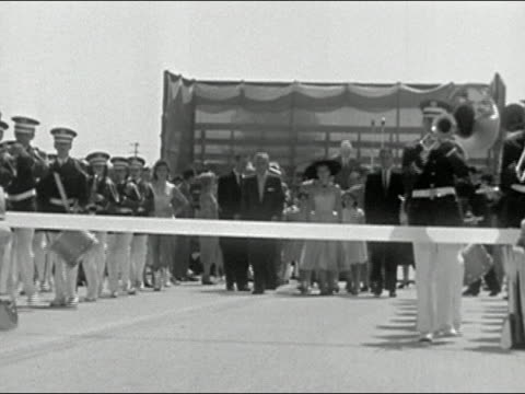 1956 black and white people walking up to ribbon in ceremony to inaugurate new highway / woman cutting ribbon - sommerkleid stock-videos und b-roll-filmmaterial