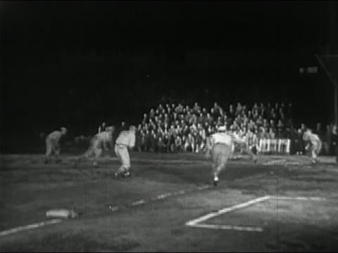 1950 black and white player trapped between third base and home plate in local league baseball game - baseballmütze stock-videos und b-roll-filmmaterial