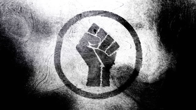 Black and white raised fist symbol on high contrasted grungy and dirty, animated, distressed and smudged 4k video background with swirls and frame by frame motion feel with street style for the concepts of solidarity,support,labor rights,strength