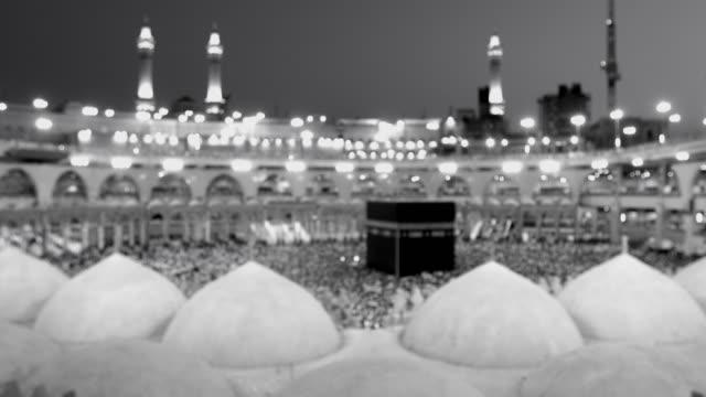 Black and white Saudi Arabia. Pilgrims circumambulate seven times to show their submission to the religion