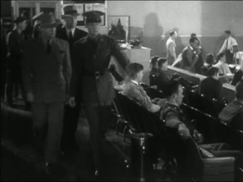 1941 black and white soldier in uniform pointing out man in crowded room / federal agents arresting accused man - big brother orwellian concept stock videos & royalty-free footage