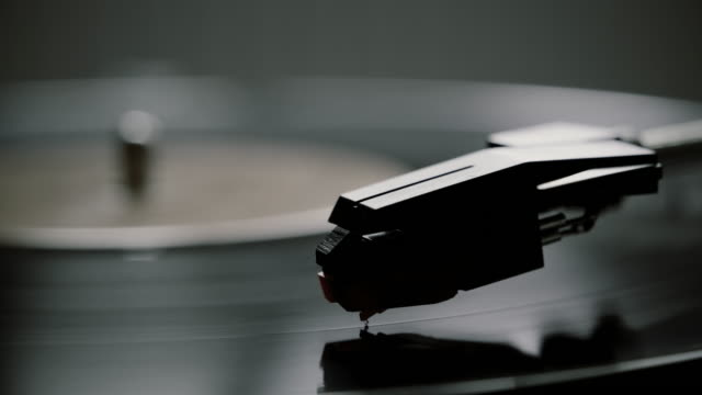 Black and white, stylus and record turntable.