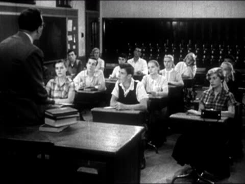 1954 black and white teacher sitting on desk in front of class of teenage students / audio - prelinger archive stock videos & royalty-free footage
