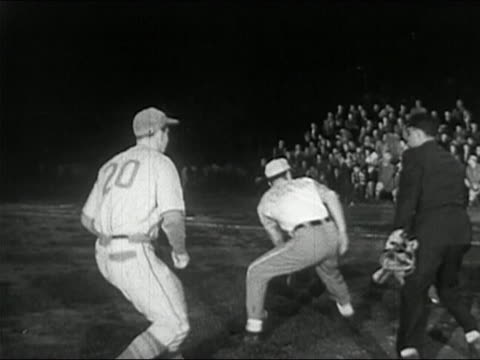 1950 black and white third baseman and catcher tagging runner in local league baseball game - baseballmütze stock-videos und b-roll-filmmaterial