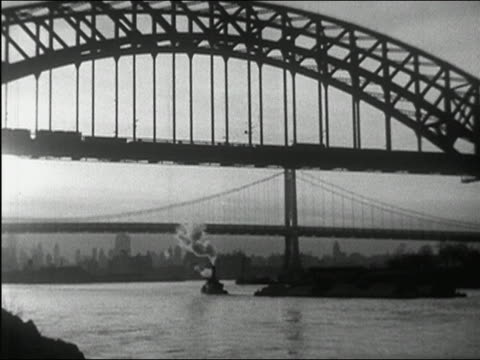 1937 black and white train crossing hell gate bridge and ship passing underneath / triborough bridge in background / nyc - tug boat stock videos & royalty-free footage