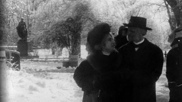 "stockvideo's en b-roll-footage met 1909 black and white wide shot couples strolling through central park in winter / ""politician's love story"" / new york - 1900 1909"