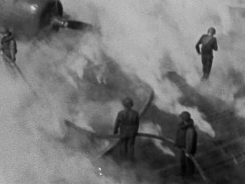 vidéos et rushes de black and white wide shot crew putting out japanese plane fire on deck of uss belleau wood / philippines - vaisseau de guerre