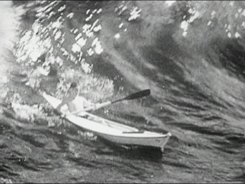 1946 black and white wide shot man paddling kayak / huge wave knocking him overboard - capsizing stock videos & royalty-free footage