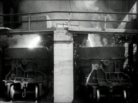 1936 black and white wide shot molten steel pouring into two ladles in foundry / sparks flying - metal industry stock videos & royalty-free footage