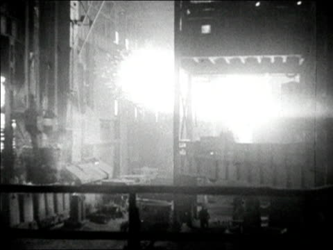1936 black and white wide shot sparks flying from bessemer converter in foundry - metal industry stock videos & royalty-free footage