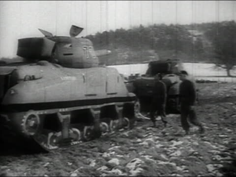 1943 black and white wide shot two soldiers walking up to inflatable tank and flipping it over - kampfpanzer stock-videos und b-roll-filmmaterial
