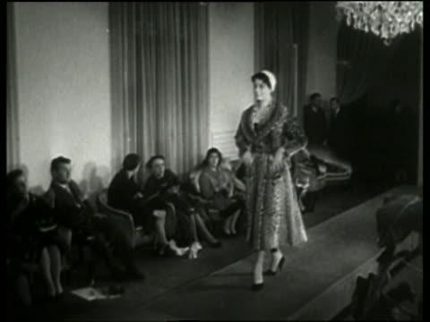 vídeos y material grabado en eventos de stock de black and white woman modeling coat on runway in fashion show / italy / no audio - arts culture and entertainment