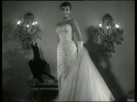 vídeos y material grabado en eventos de stock de black and white woman modeling sequined dress in fashion show / no audio - arts culture and entertainment