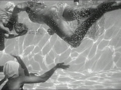 1946 black and white women in bathing suits swimming and playing basketball underwater - swimming cap stock videos and b-roll footage