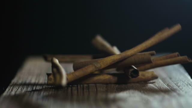black background, cinnamon sticks - cinnamon stock videos & royalty-free footage