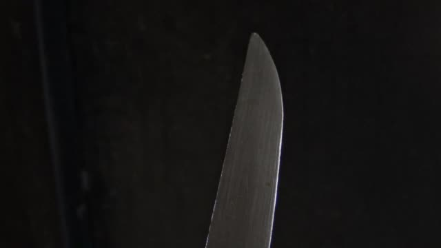 black background knife video. scary knife - table knife stock videos & royalty-free footage