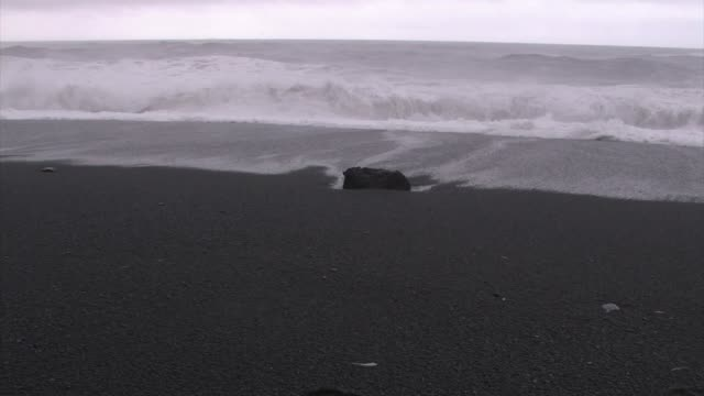 black basalt sand beach pounded by surf. - dyrholaey stock videos & royalty-free footage