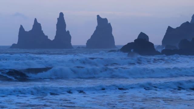black beach in reynisdrangar - igneous stock videos & royalty-free footage