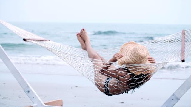 black bikini sexy women - lying down stock videos & royalty-free footage