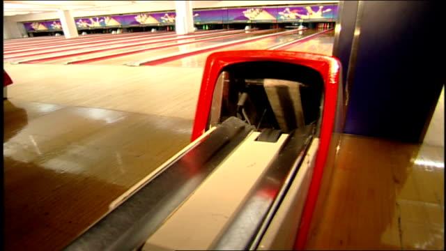 black bowling ball coming up through bowl return - bowling ball stock videos & royalty-free footage