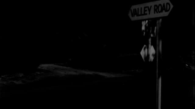 "a black buick travels up a dirt road and turns a corner near a street sign that reads ""valley road"". - 1938 stock videos & royalty-free footage"