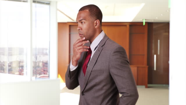 a black businessman looks out his office window - ladder of success stock videos & royalty-free footage