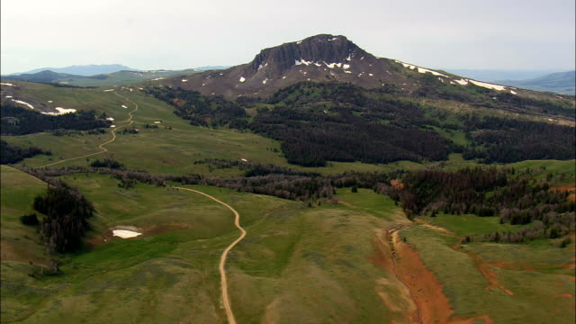black butte  - aerial view - montana,  madison county,  helicopter filming,  aerial video,  cineflex,  establishing shot,  united states - butte rocky outcrop stock videos and b-roll footage