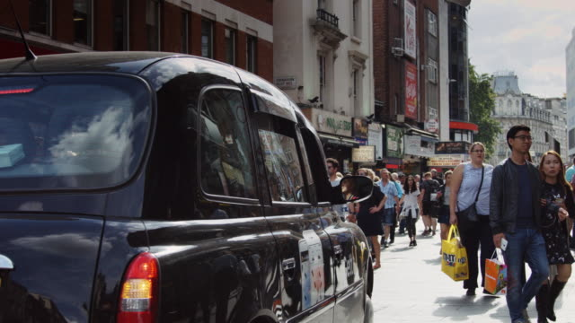 black cab in soho - taxi stock videos & royalty-free footage