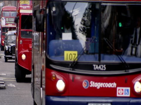 black cabs routemaster buses and pedestrians in busy street - bus stock videos & royalty-free footage