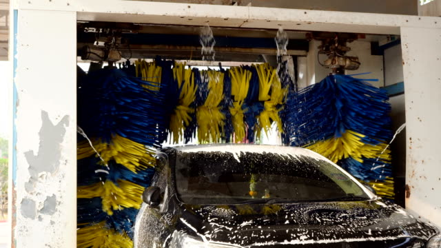 black car being soaped and washed by auto machine - automatic stock videos & royalty-free footage