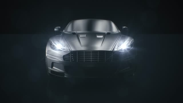 black car front view 3d render on black background - headlight stock videos & royalty-free footage