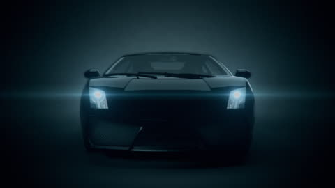 black car front view 3d render on black background - luxury stock videos & royalty-free footage