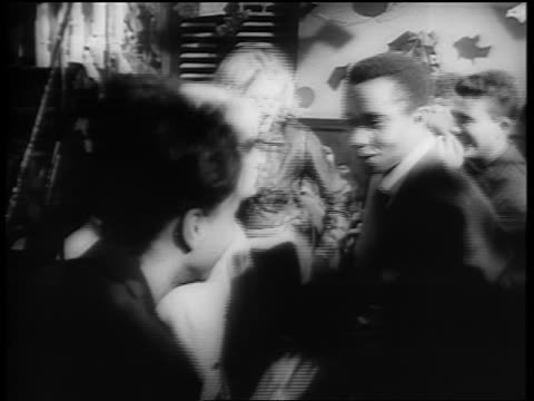 b/w 1961 black + caucasian couples dancing the twist on dance floor / newsreel - 1961 stock-videos und b-roll-filmmaterial
