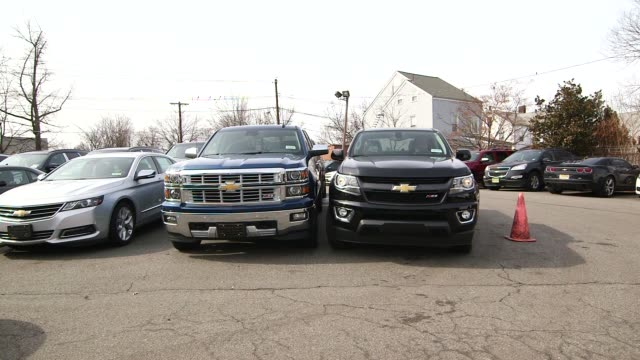 a black chevrolet truck in a chevrolet dealership in new york city new york on march 12th 2015 shots close and wide shots of a black chevrolet truck... - chevrolet truck stock videos & royalty-free footage