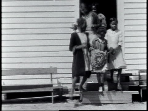 1940 ws black children exiting calhoun school house / calhoun, alabama, united states - separation stock videos & royalty-free footage