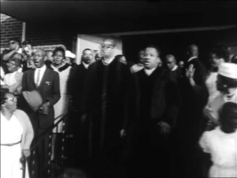 Black clergy exiting church in civil rights demonstration / Alabama / newsreel