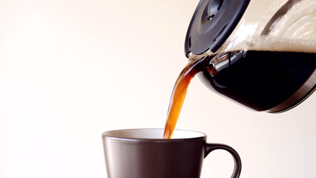 black coffee pouring into cup