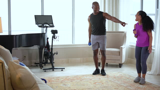 black couple at home exercising together, doing lunges - hand weight stock videos & royalty-free footage