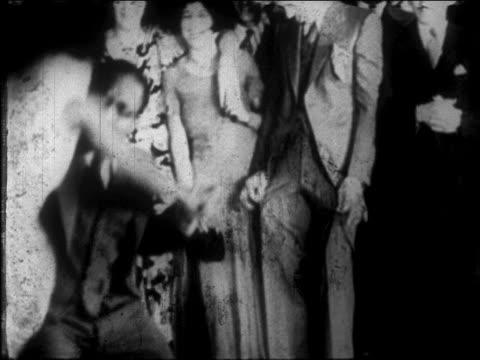 vídeos de stock, filmes e b-roll de b/w 1927 black couple dancing lindy hop in harlem nightclub / nyc / newsreel - 1920