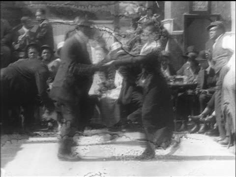 B/W 1914 Black couple dancing spinning madly as dog jumps around them / San Francisco / newsreel