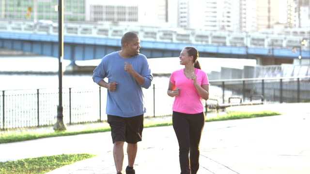 black couple exercising together in the city - racewalking stock videos and b-roll footage