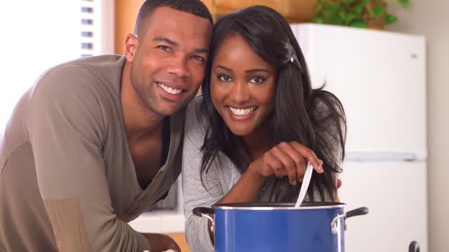 Black couple making pasta