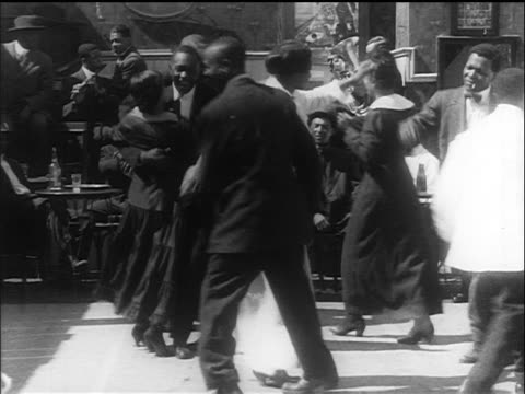 B/W 1914 Black couples dancing / switching partners + dancing in circle / San Francisco / newsreel