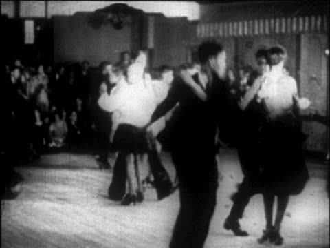 vídeos de stock e filmes b-roll de b/w 1927 black couples hopping + dancing lindy hop in harlem nightclub / nyc / newsreel - dança jive