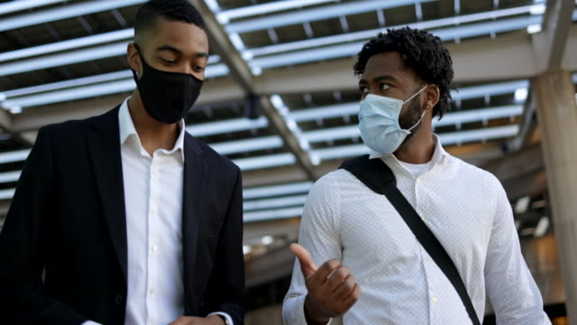 black coworker businessmen wearing a mask - after work stock videos & royalty-free footage