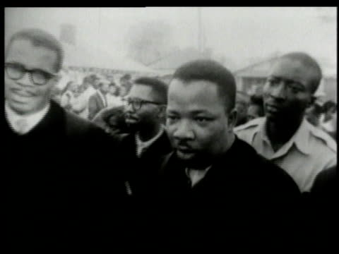 black crowd lead by martin luther king jr walking in protest of segregation / alabama united states - jim crow laws stock videos & royalty-free footage