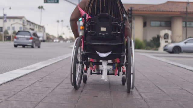 black disabled woman in a wheelchair moving - boulevard stock videos & royalty-free footage