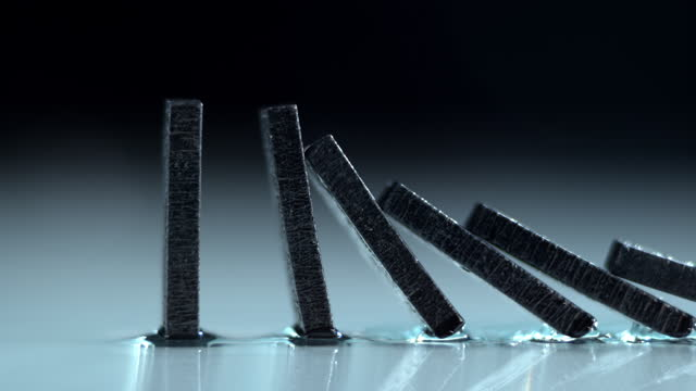 slo mo ts black domino tiles falling down - continuity stock videos & royalty-free footage